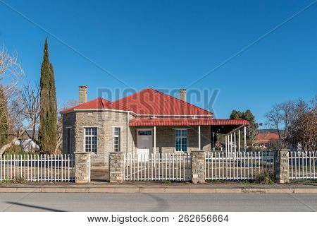Sutherland, South Africa, August 8, 2018: A Street Scene, With An Old House With Two Chimneys, In Su