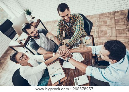 Young Workers On Teambuilding In Modern Office. Communication With Colleagues. Teambuilding At Work.