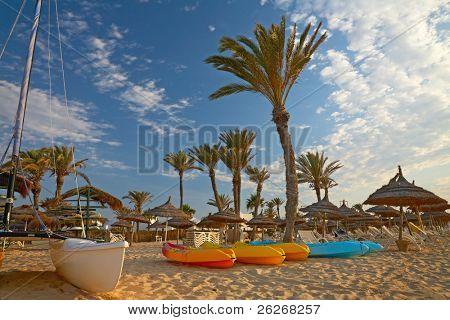 kayaks and catamaran on the beach