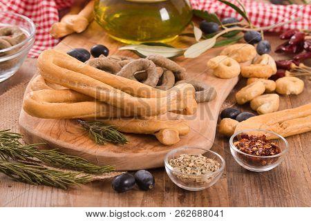 Italian Taralli With Spices On Cutting Board.