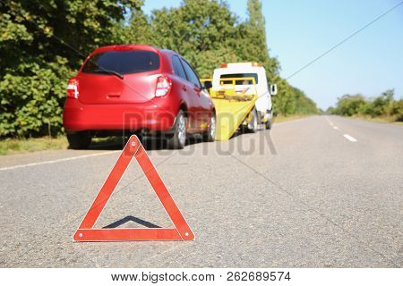 Emergency Stop Sign With Broken Car And Tow Truck On Background. Space For Text