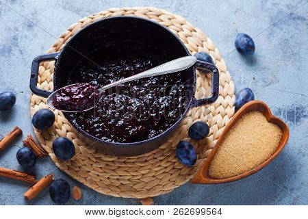 sweet homemade plum jam and fruits on a table - food and drink