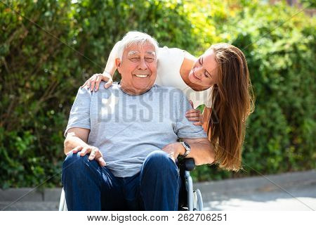 Portrait Of Happy Father And Daughter At Outdoors