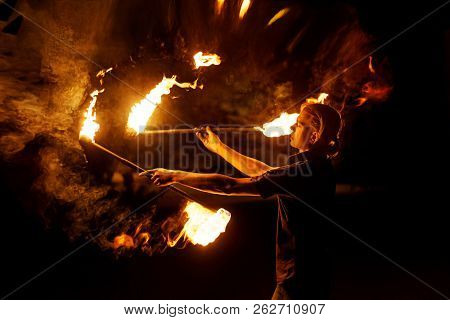 Fire Show. Fakir Dances With Two Staff. Night Performance. Dramatic Portrait. Fire And Smoke