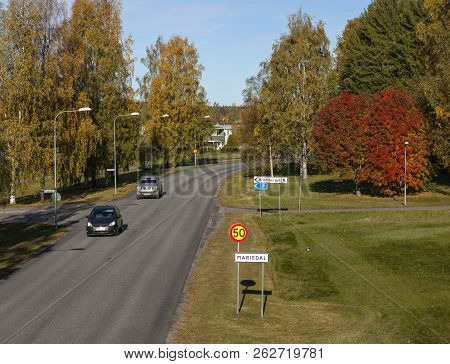 Umea, Sweden On October 04. View Of Colorful Trees Beside A Street In A Residential Area On October