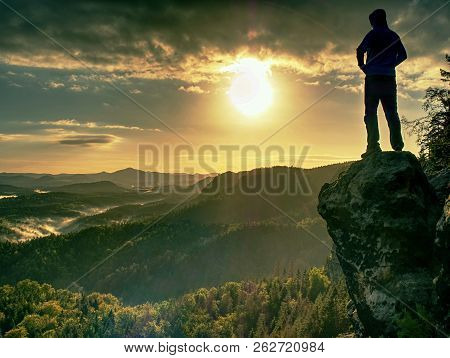 Man Walking On The Edge Of A Cliff At Summit. Hrensko Range,  Czech Republic 21st Of Seprtember 2018