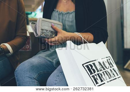Black Friday. Cropped View Of A Female Shopper Takes Money From The Wallet To Pay The Purchase In A