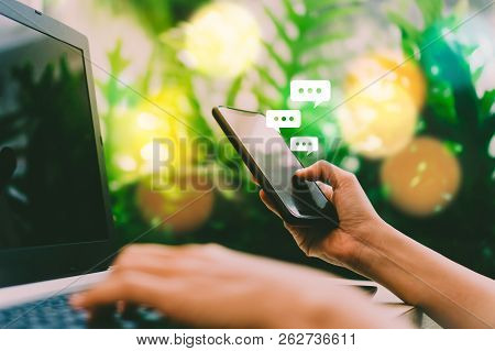 Women Hand Using Smartphone Typing, Chatting Conversation In Chat Box Icons Pop Up. Social Media Mak