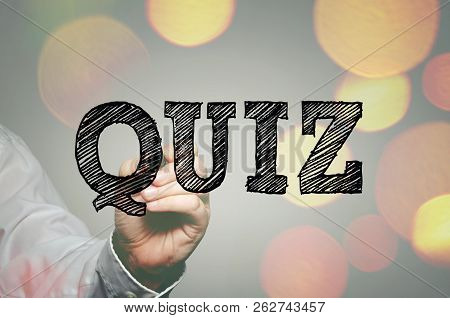 Businessman`s Hand Writing Quiz Text With Felt Tip Pen On Transparent Wipe Board
