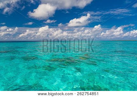Beautiful White Clouds On Blue Sky Over Calm Sea With Sunlight Reflection. Tranquil Sea Harmony Of C