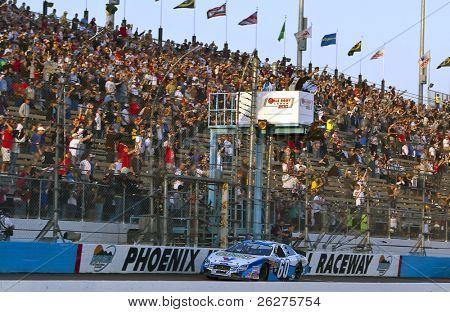 AVONDALE, AZ - NOV  14: Carl Edwards wins the Able Body Labor 200 race at the Phoenix International Raceway on November 14, 2009 in Avondale, AZ.