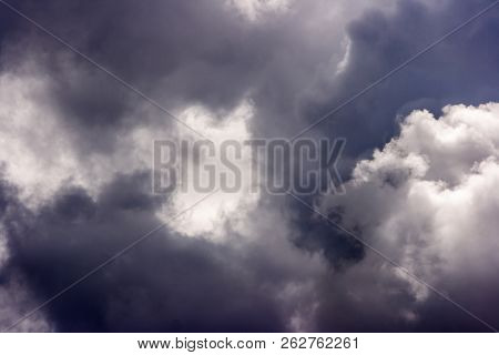 Storm Cloud On Sunny Day. Light In The Dark And Dramatic Storm Clouds. Background Of Storm Clouds Be