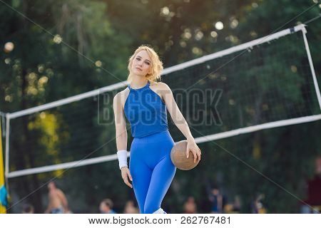 Young Beautiful Sporty Girl Outdoor In Volleyball Game. Attractive Slim Sexy Woman Standing With Bal