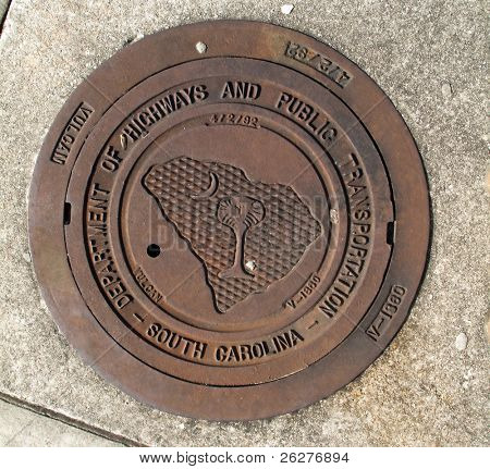 A manhole cover at a rest stop near Greenville, SC.