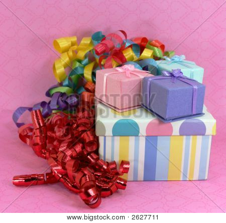 Pile Of Gifts On Pink Background