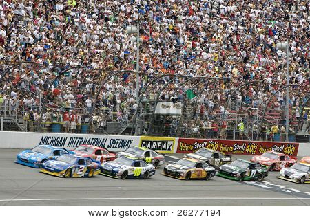 BROOKLYN, MI - JUNE 13:   The NASCAR Spint Cup cars take the green flag for the Heluva Good! Sour Cream Dips 400 race at the Michigan International Speedway in Brooklyn, MI on June 13, 2010