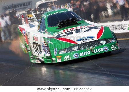 GAINESVILLE, FL - MAR 14:    Ashley Force-Hood brings her Castrol GTX funny car down the track during the 41st Annual Gatornationals at the Gainesville Raceway in Gainesville, FL on Mar 14, 2010.