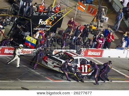 HAMPTON, GA - SEP 05:  Denny Hamlin brings his Sports Clips Toyota in for service during the Emory Healthcare 500 race at the Atlanta Motor Speedway in Hampton, GA on Sep 05, 2010.