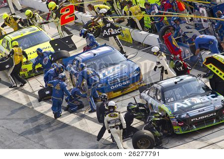 DOVER, DE - SEP 26:  Pit Road gets busy drivers bring their race cars in for service during the AAA 400 race at the Dover International Speedway in Dover, DE on Sep 26, 2010.