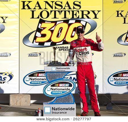 KANSAS CITY, KS - OCT 02:  Joey Logano holds off a hard charging field to win the Kansas Lottery 300 race on October 2, 2010 at the Kansas Speedway in Kansas City, KS.