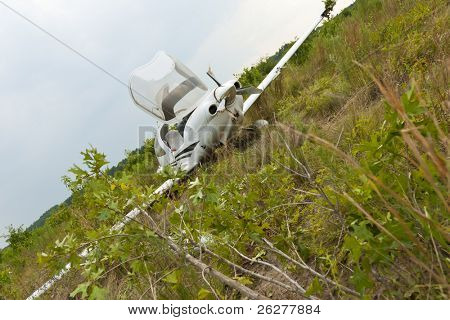 Small general aviation aircraft crash lands in a field poster