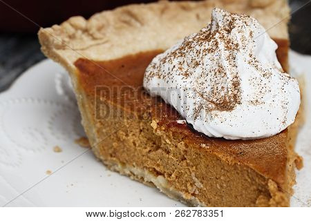 Slice Of Homemade Pumpkin Pie With Topping And Sprinkled With Pumpkin Pie Spice. Extreme Shallow Dep
