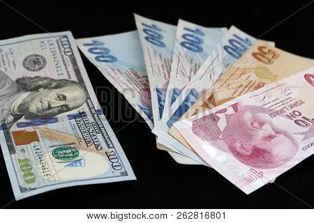 100 Turkish Liras And 100 Dollars On The Black Floor,