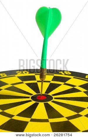 A green dart in a dartboard bullseye.