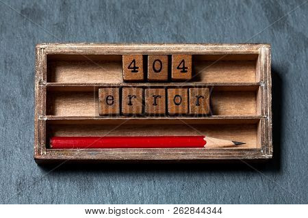 Error 404 Page Not Found. Vintage Box, Wooden Cubes With Old Style Letters And Red Pencil. Gray Ston