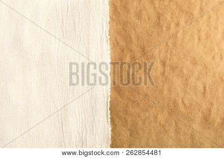 Top View Of White Woven Canvas Cloth On Beach Sand Background. White Fabric On Sand With Empty Place