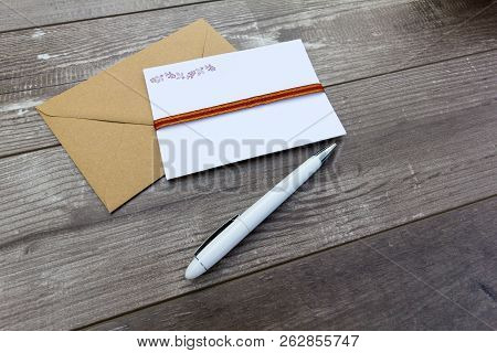 Letter Writing Concept - Pen, Writing Paper And Envelope On A Wooden Background