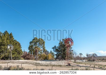 Farm Landscape On Road R356 Between Loxton And Fraserburg In The Northern Cape Province. 9 Water-pum