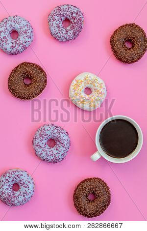 Delicious Glazed Donuts And Cup Of Coffee On Pink Surface. Flat Lay Minimalist Food Art Background.