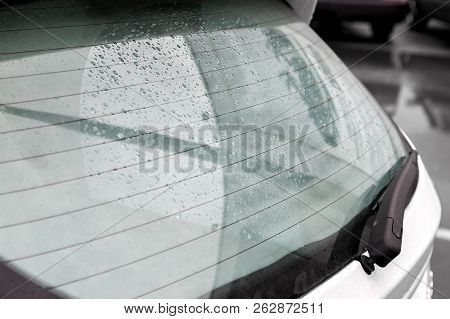 The Swirling Rear Window Of The Car Covered With Drops Of Water After The Rain, Heated Rear Window A