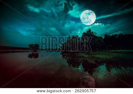 Landscape Of Dark Night Sky. Beautiful Bright Full Moon And Cloudy Above Silhouettes Of Trees, River