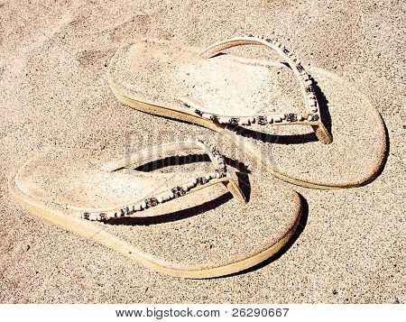 Pair of Sandles in the sand