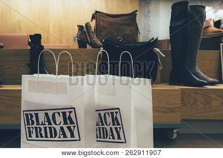 Black Friday. Close Up Of Shopping Bags Printed With Black Friday Text In A Shoe Shop.