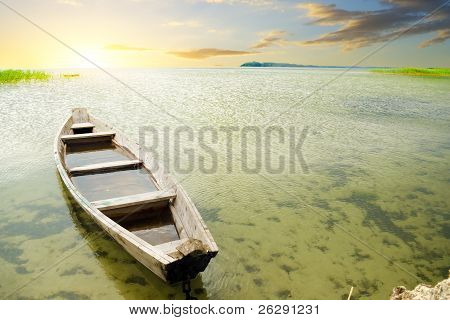 Boat At Coast Against A Sunset