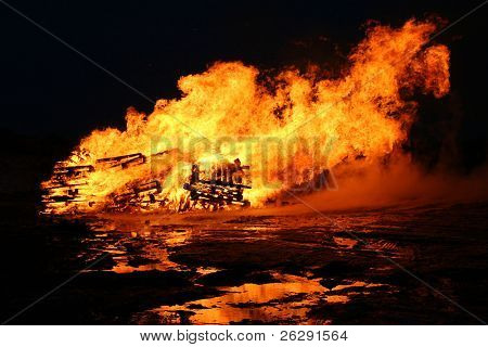 Fire and flames on a black background - taken at night