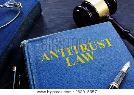 Antitrust Law Book And Gavel On A Desk.