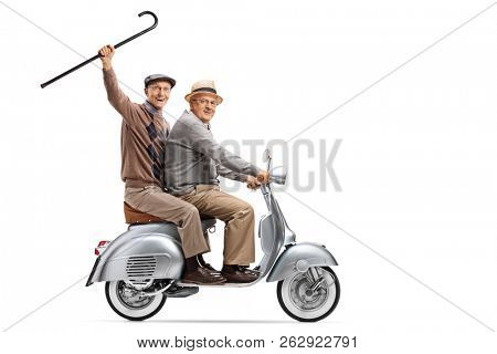Full length shot of two senior men on a vintage scooter, one holding a cane up isolated on white background
