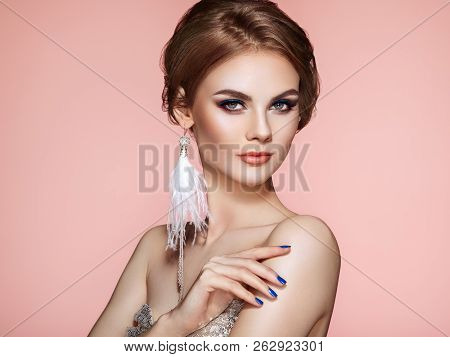 Portrait Beautiful Woman With Jewelry. Model Girl With Blue Manicure On Nails. Elegant Hairstyle. Bl