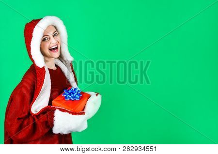 Smiling Woman In Santa Helper Hat With Gift Box. Beautiful Christmas Girl. Christmas Present. Happy