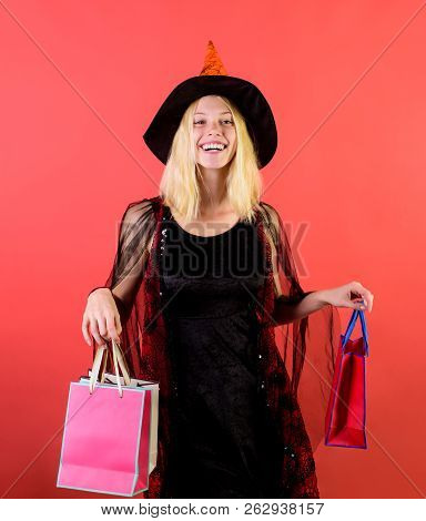 Girl In Halloween Witch Costume With Shopping Bags. Holiday Celebration. Happy Halloween Shopping. S