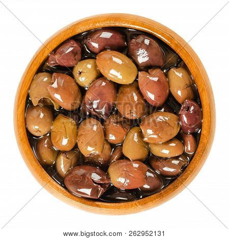 Pitted Taggiasca Olives In Wooden Bowl. Small, Fruity Olives From Taggia In Linguria, A Region In It