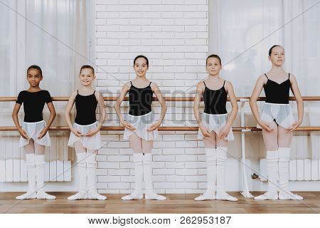 Ballet Training Of Group Of Young Girls Indoors. Classical Ballet. Girl In Balerina Tutu. Training I