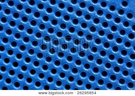 Hole pattern grid of an electronic device in blue