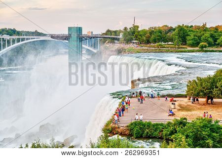 Niagara Falls, Usa - Aug 26, 2012: Tourists On The Waterfall Observation Deck At Niagara Falls Overl