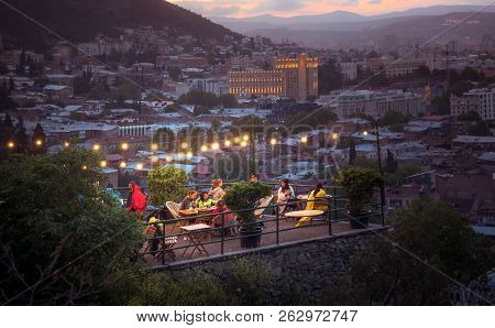 Tbilisi, Georgia - June 15, 2017: People Are Resting In A Cafe On The Terrace In The Evening. Restau