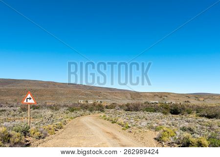 A Landscape, With Road Sign And Farm Buildings, On Road R356 To Ceres In The Western Cape Province